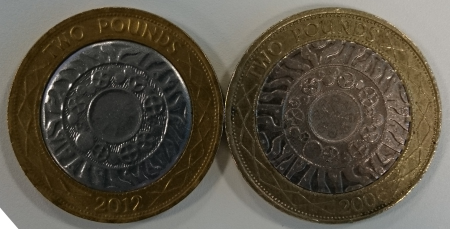 Reverse of real and fake coin, side by side
